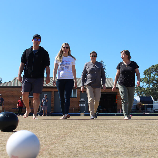 Group playing lawn bowls