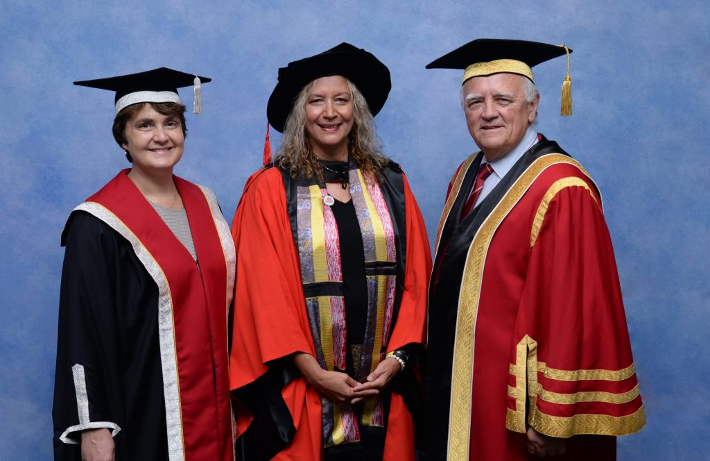 Three people in academic dress
