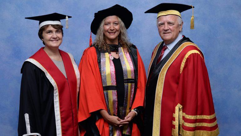 Three people in academic dress
