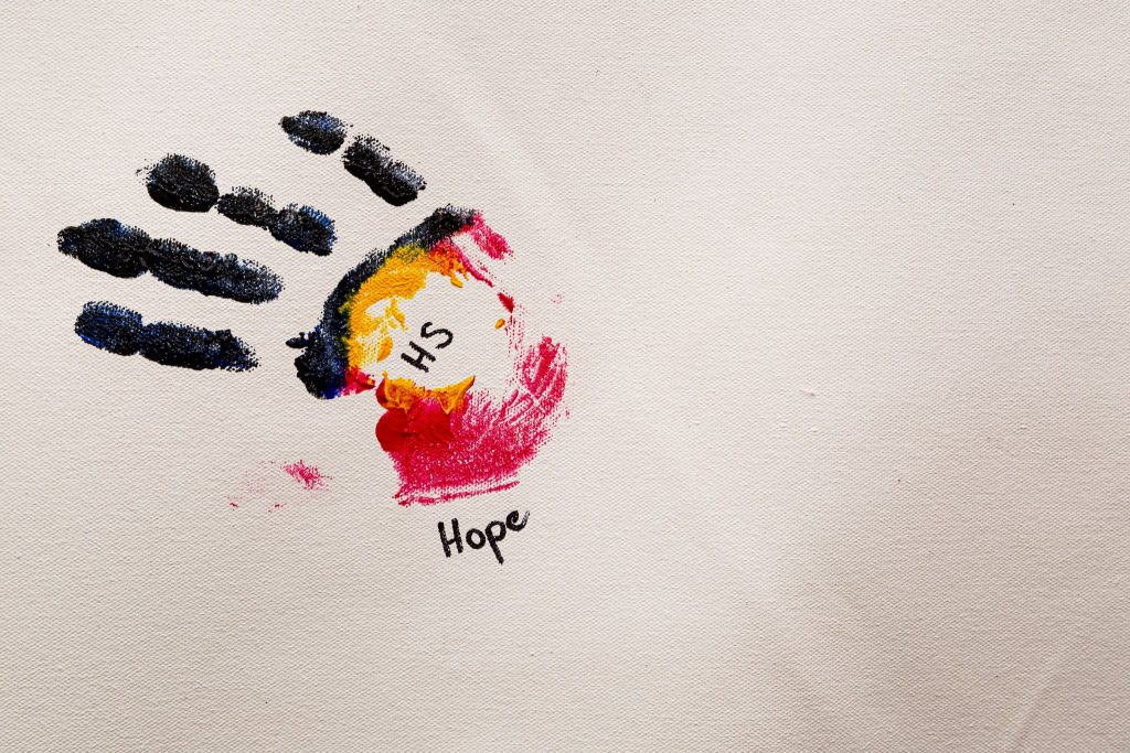 Paint handprint with word Hope underneath