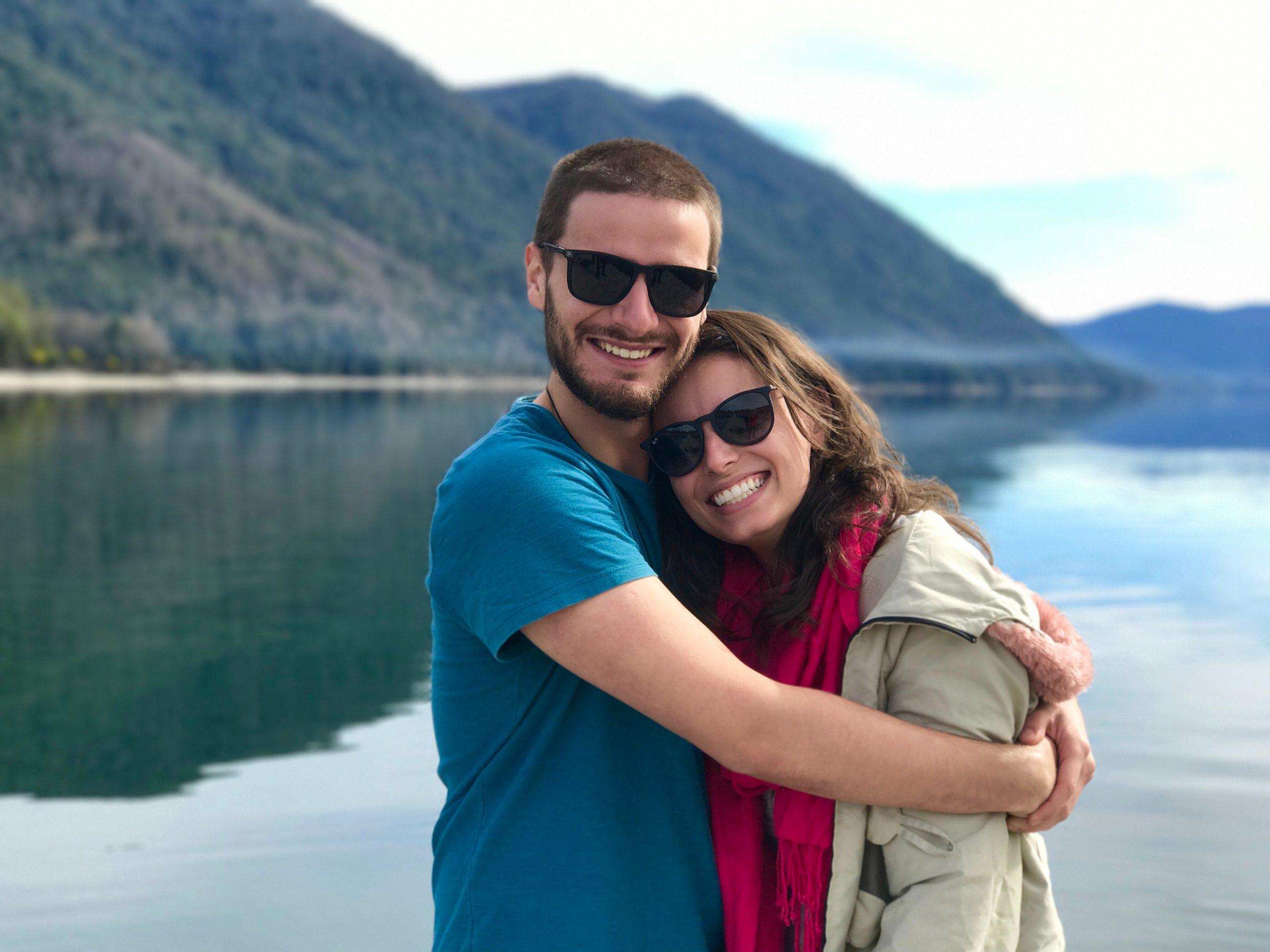 couple hugging at a lake