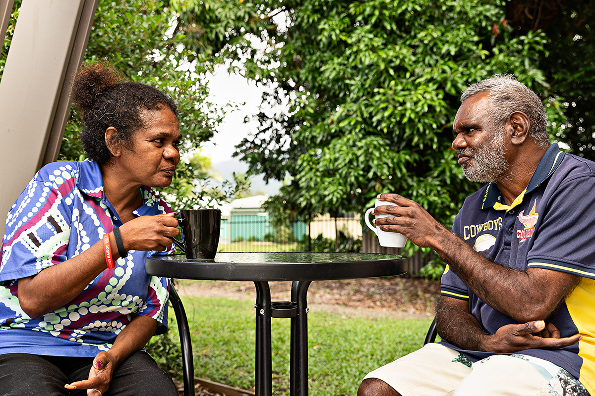 Two people sharing a cup of tea